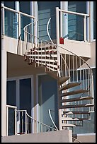 Facade detail of beach house with spiral stairway. Santa Monica, Los Angeles, California, USA