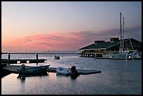 Marina, with small boat comming back to port at sunset. Redwood City,  California, USA (color)