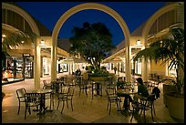 Sitting at outdoor table at night, Stanford Shopping Center. Stanford University, California, USA