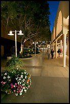 Couple walking by stores and flowers, Stanford Shopping Center. Stanford University, California, USA
