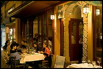 Outdoor table of Italian restaurant at night. Burlingame,  California, USA ( color)