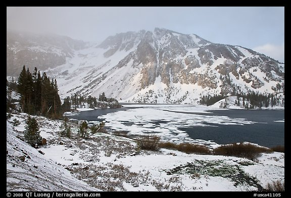 Partly frozen Ellery Lake and mountains with snow. California, USA (color)