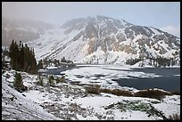Partly frozen Ellery Lake and mountains with snow. California, USA ( color)
