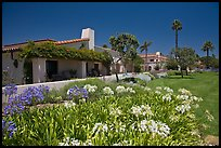 Mediterranean-style houses, flowers, and palm trees. Santa Barbara, California, USA (color)