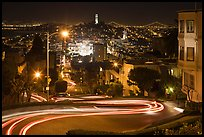 Sharp switchbacks on Russian Hill with Telegraph Hill in the background, night. San Francisco, California, USA ( color)