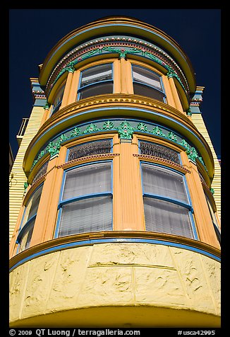Brightly painted yellow tower of Victorian house, Haight-Ashbury District. San Francisco, California, USA (color)