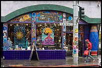 Rainny sidewalk and store with psychadelic colors. San Francisco, California, USA ( color)