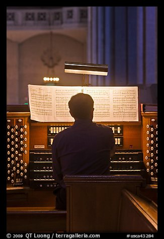 Musician playing organ, Grace Cathedral. San Francisco, California, USA (color)
