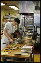 Man preparing pizza, Haight-Ashbury district. San Francisco, California, USA ( color)