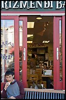 Man biting pizza outside pizzaria, Haight-Ashbury district. San Francisco, California, USA ( color)