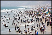 Crowds of beachgoers in water. Santa Monica, Los Angeles, California, USA (color)