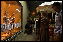 People watch performance artists in window, Bergamot Station. Santa Monica, Los Angeles, California, USA
