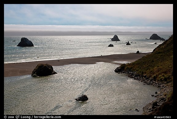 Shimmering ocean and river separated by sliver of sand, Jenner. Sonoma Coast, California, USA