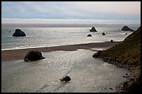 Shimmering ocean and river separated by sliver of sand, Jenner. Sonoma Coast, California, USA (color)