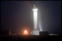 Fog and Point Arena Lighthouse by night. California, USA ( color)