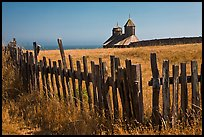 Fences, summer grass and chapel towers, Fort Ross. Sonoma Coast, California, USA