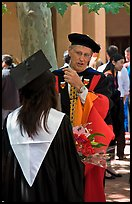 Faculty in academic dress talks with student. Stanford University, California, USA (color)