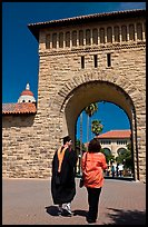 Graduate and family member walking through Main Quad. Stanford University, California, USA (color)