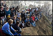 Spectators sitting on cliff to see mavericks contest. Half Moon Bay, California, USA ( color)