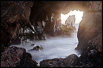 Looking through Pfeiffer Beach arch. Big Sur, California, USA