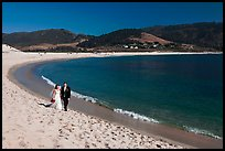Groom and bride, Carmel River Beach. Carmel-by-the-Sea, California, USA (color)