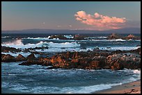 Surf and rocks at sunset, Monterey Bay. Pacific Grove, California, USA