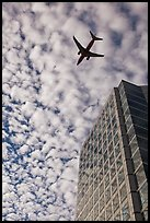 Adobe Tower and commercial aircraft. San Jose, California, USA