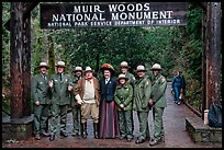 Rangers posing with Theodore Roosevelt under entrance gate. Muir Woods National Monument, California, USA (color)