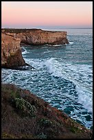 Wave and sea  cliffs at sunset, Wilder Ranch State Park. California, USA