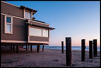 Pilings and beach house at sunset, Stinson Beach. California, USA ( color)