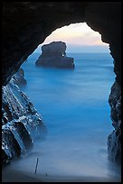 Ocean seen from sea arch at sunset, Davenport. California, USA