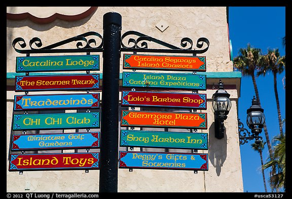 Signs pointing to local businesses, Avalon Bay, Catalina. California, USA (color)