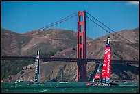 USA and New Zealand America's cup boats and Golden Gate Bridge. San Francisco, California, USA (color)