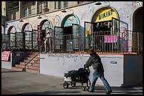 Man pushing cart in front of stores. Venice, Los Angeles, California, USA ( color)