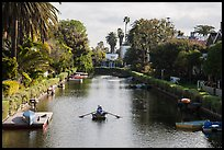 Woman rowing in canal. Venice, Los Angeles, California, USA ( color)