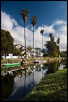Houses, boats, and palm trees along canal. Venice, Los Angeles, California, USA ( color)