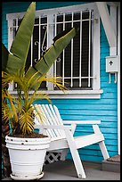 Matching white garden chair, flower pots, and window on porch. Venice, Los Angeles, California, USA ( color)