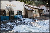 Adobe buildings and artificial flood, Universal Studios. Universal City, Los Angeles, California, USA ( color)