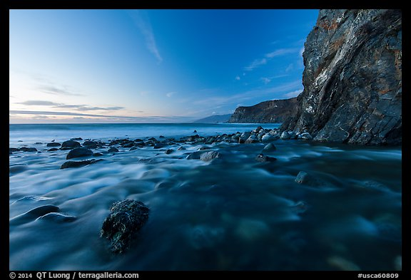Creek, boulders, cliff, and ocean at dusk. Big Sur, California, USA (color)