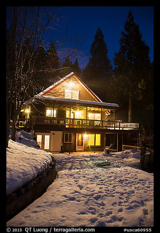 Cabin with window lights in winter. California, USA (color)