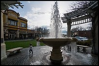 Fountain and plaza with child playing. Livermore, California, USA ( color)