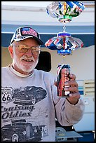 Man with mobile he made out of cans, Slab City. Nyland, California, USA ( color)