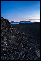 Interior slopes of Amboy Crater and mountains at dusk. Mojave Trails National Monument, California, USA ( color)