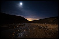 Moon shining inside Amboy Crater at night. Mojave Trails National Monument, California, USA ( color)
