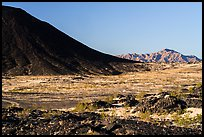 Lava field, Amboy Crater slope and mountains. Mojave Trails National Monument, California, USA ( color)