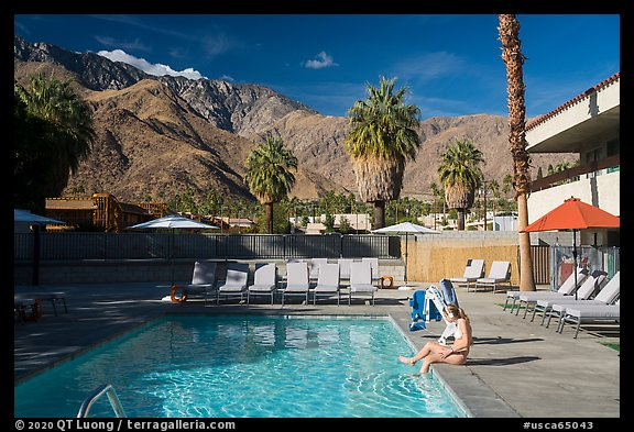 Woman at swimming pool and San Jacinto Mountains, Palm Springs, Palm Springs. California, USA (color)
