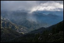 Rolling peaks under storm sky with shaft of light. San Gabriel Mountains National Monument, California, USA ( color)