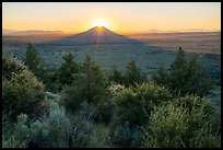 Whitney Butte with sun setting. Lava Beds National Monument, California, USA ( color)