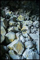Colored rocks from collapsed ceilling, Big Painted Cave. Lava Beds National Monument, California, USA ( color)