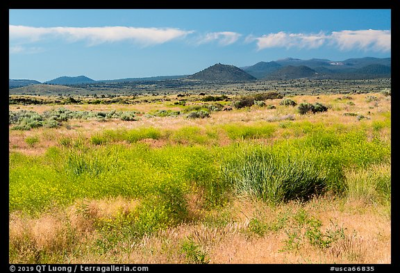 Grasslands and volcanic buttes. Lava Beds National Monument, California, USA (color)